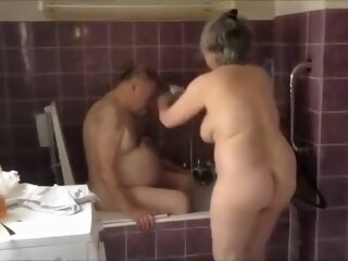 Busty granny washes her..