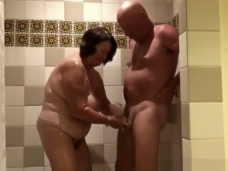 Chubby mature woman handjob..