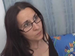 Mature brunette with glasses..